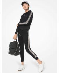 Michael Kors Felpa in nylon con cappuccio zip e fettuccia con logo - Nero