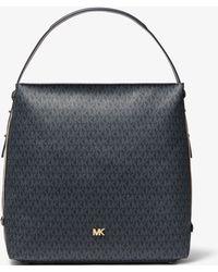 Michael Kors Grand sac porté épaule Griffin à logo - Noir
