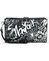 Michael Kors - Adele Graffiti Leather Smartphone Wallet - Lyst