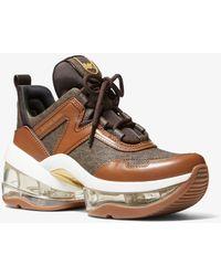 Michael Kors Sneaker Olympia Extreme Aus Logostoff Und Leder - Braun
