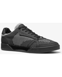Michael Kors Adrian Two-tone Stretch Knit And Rubberized Leather Sneaker - Black