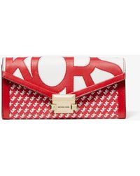 6593a2096a8f MICHAEL Michael Kors - Whitney Large Graphic Logo Chain Wallet - Lyst