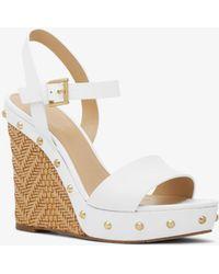 08badd63dc58 Lyst - Michael Kors Brown Ellen Wedge Sandals in Brown