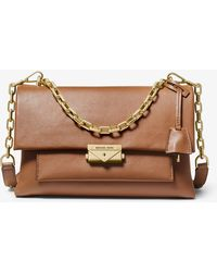 7bb293f7453 Lyst - Michael Kors Gia Small Quilted-Leather Crossbody in Natural