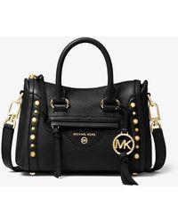 Michael Kors Carine Extra-Small Studded Pebbled Leather Crossbody Bag - Schwarz