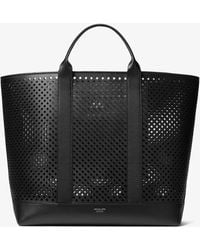 f4557bdc19db Michael Kors - Georgica Oversized Perforated Leather Tote Bag - Lyst