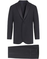 Brioni Hand-tailored Black Super 160's Wool Policleto Tuxedo With Single-breasted Blazer And Pants.