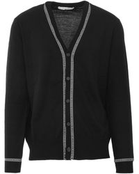Givenchy Black Wool Cardigan With Buttoning And V-neckline Outlined By White Logoed Stripes.