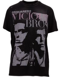 DSquared² Stonewashed Black T-shirt With Destroyed Effect And Photographic Print On The Front