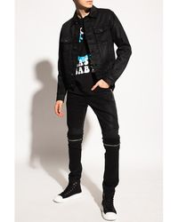 Amiri Distressed jeans Negro