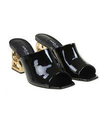 Dolce & Gabbana Mules in patent Negro