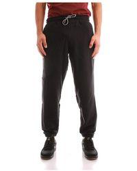 New Balance Mp13503bk Trousers - Zwart