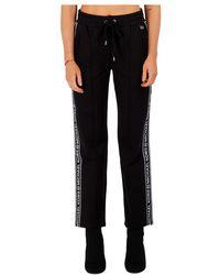Michael Kors Pantalon avec bandes latérales à logo - Noir