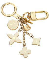 Louis Vuitton Amuleto lock me strass de segunda mano metal latón - Amarillo