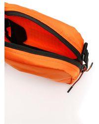 Heron Preston Ctnmb camera bag Naranja