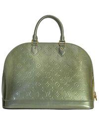 Louis Vuitton Alma en cuir vernis Verde