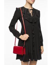 Alaïa Studded shoulder bag Rojo