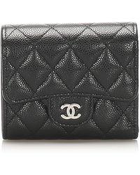 Chanel Vintage Cartera de piel de caviar atemporal de dos pliegues de segunda mano - Negro