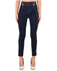Versace - Jeans Skinny Con Bustino Alto - Lyst