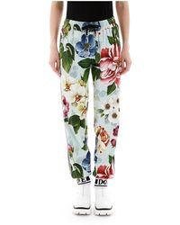 Dolce & Gabbana Floral Print jogger Pants - Blauw