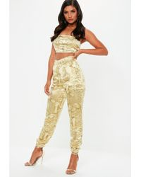 96f14ede948 Lyst - Missguided Gold Paperbag Waist Satin Wide Leg Trousers in ...