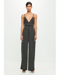 Missguided - Peace + Love Black Strappy Hotfix Flared Jumpsuit - Lyst