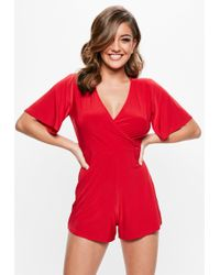Missguided - Red Slinky Wrap Playsuit - Lyst