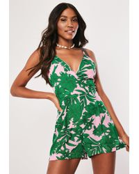 dcd55b38ea Missguided Red Tropical Palm Print Plunge Tie Back Playsuit in Red ...