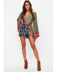 Missguided - Khaki Flared Sleeve Scarf Printed Playsuit - Lyst