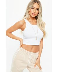 a6e8bbd1f07 Lyst - Missguided Ribbed High Neck Crop Top White in Blue