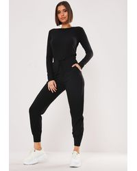 Missguided Black Rib Long Sleeve Tie Waist Jogger Romper