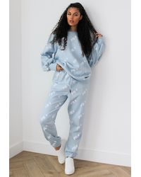 Missguided X Petite Blue Repeat Print Joggers