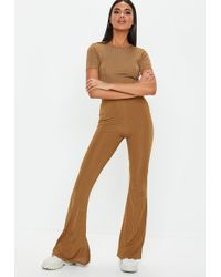 Missguided - Rust Shiny Ribbed Flare Trousers - Lyst