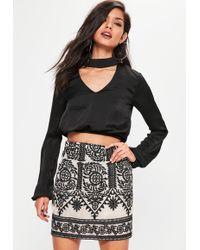 d974fd2b89 Lyst - Missguided Premium Bandage Wrap Mini Skirt Silver in Gray