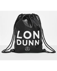 Missguided Londunn + Black Faux Leather Drawstring Bag