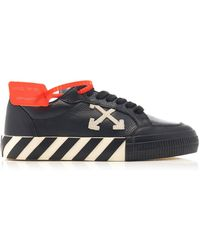 Off-White c/o Virgil Abloh *icon Black Vulcanized Leather Sneakers With Diagonal Stripes On The Sole And Arrows On The Side.
