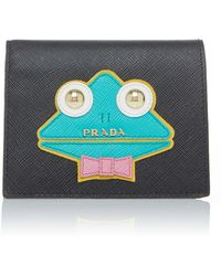 Prada - Appliquéd Textured-leather Wallet - Lyst