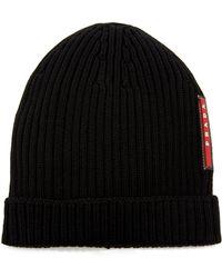 4aaeb93679d Prada - Logo-appliquéd Ribbed Wool Beanie - Lyst