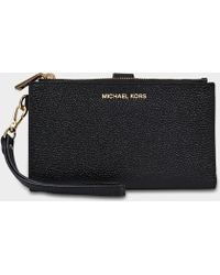 MICHAEL Michael Kors - Double Zipped Wristlet In Black Calfskin - Lyst