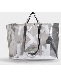 Off-White c/o Virgil Abloh - Arrows Tote Bag In Silver And White Pvc - Lyst