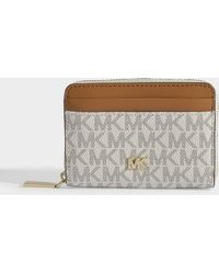 8ad06889858d MICHAEL Michael Kors - Zipped Around Coin Card Case In Vanilla Coated  Canvas - Lyst
