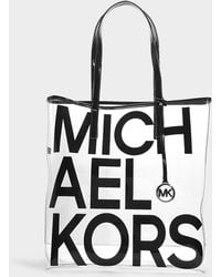 9060f6127be7 MICHAEL Michael Kors - The Michael Large North south Tote In Black Plastic  - Lyst