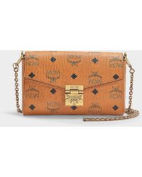 aab48f66148 MCM - Millie Visetos Small Crossbody Bag In Cognac Coated Canvas - Lyst