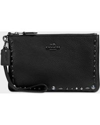 COACH - Small Wristlet Pouch With Rivets In Black Calfskin - Lyst
