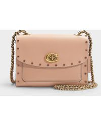 9fd80c62c7daa COACH - Crystal Border Rivets Parker 18 Shoulder Bag In Pink Calfskin - Lyst