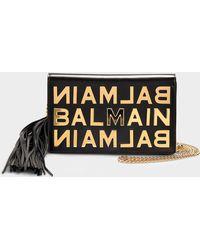 Balmain - Logo Metallic Letters Pouch In Black Calfskin - Lyst