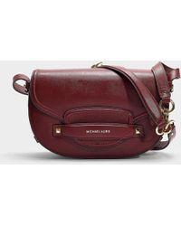 5119e61ae049 MICHAEL Michael Kors - Cary Medium Saddle Bag In Burgundy Calfskin - Lyst