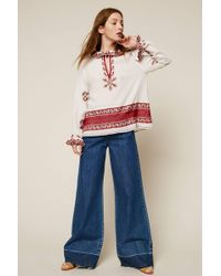 INTROPIA - Flared Jeans - Lyst
