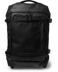 Eastpak Tranverz Small 51cm Leather-trimmed Canvas Carry-on Suitcase - Black