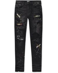 Amiri Skinny-fit Appliquéd Distressed Stretch-denim Jeans - Black